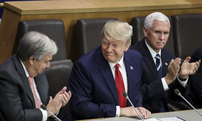 (L-R) United Nations (U.N.) Secretary General Antonio Guterres and U.S. Vice President Mike Pence (R) applaud after U.S. President Donald Trump spoke during a meeting on religious freedom at U.N. headquarters in New York City on Sept. 23, 2019. While hundreds of world leaders gather for the climate summit during the U.N. General Assembly, President Trump chose to skip the event in favor of his own meeting on religious freedom and persecution. (Drew Angerer/Getty Images)