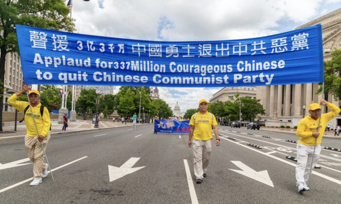 Falun Gong practitioners hold a banner in support of the 330 million Chinese who have withdrawn from the Chinese Communist Party, during a parade in Washington on July 18, 2019. (Mark Zou/The Epoch Times)