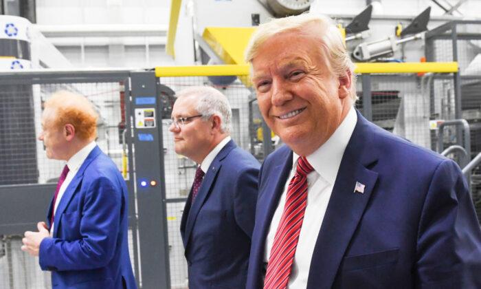 President Donald Trump (R), Global Chairman of Pratt/Visy Industries Anthony Pratt (L) and Australian Prime Minister Scott Morrison visit Pratt Industries during the plant's opening in Wapakoneta, Ohio on Sept. 22, 2019. (Saul Loeb/AFP/Getty Images)