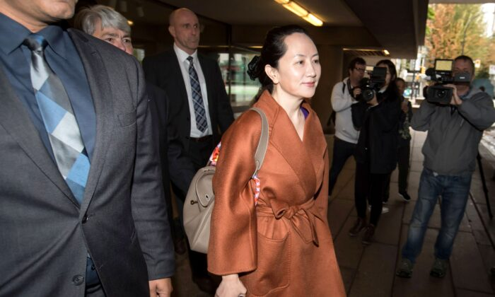 Huawei chief financial officer Meng Wanzhou, who is out on bail and remains under partial house arrest after she was detained last year at the behest of American authorities, leaves the B.C. Supreme Court in Vancouver during lunch break from a hearing on Sept. 23, 2019. (THE CANADIAN PRESS/Darryl Dyck)