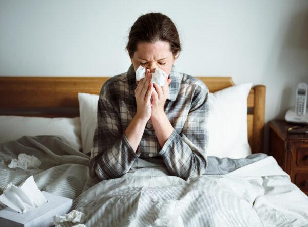 A woman suffering from flu. (Shutterstock)