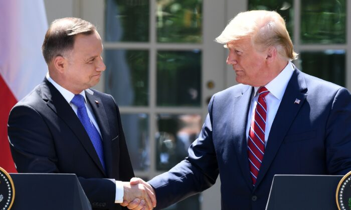 President Trump and Polish President Andrzej Duda shake hands after holding a joint press conference in the Rose Garden of the White House in Washington on June 12, 2019. (SAUL LOEB/AFP/Getty Images)