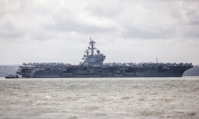US Navy Nimitz-class aircraft carrier USS George H.W. Bush is pictured anchored off the coast in Portsmouth, England, on July 27, 2017. (Photo by Jack Taylor/Getty Images)