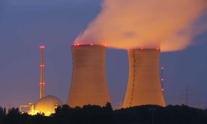Steam rises from the cooling towers of the Grafenrheinfeld nuclear power plant at night near Grafenrheinfeld, Germany, on June 11, 2015. (Sean Gallup/Getty Images)