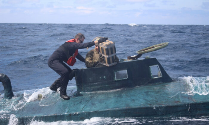 Crews intercepted a drug-laden, 40-foot self-propelled semi-submersible (SPSS) in the Eastern Pacific carrying approximately 12,000 pounds of cocaine, worth over $165 million and apprehended four suspected drug smugglers. (U.S. Coast Guard Photo)