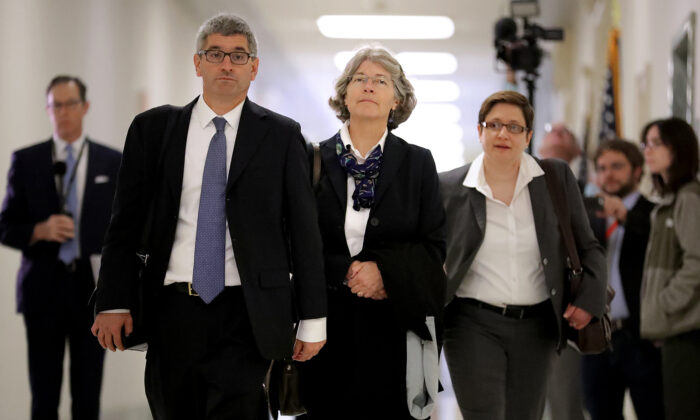 Fusion GPS contractor Nellie Ohr (C) arrives for a closed-door interview with investigators from the House Judiciary and Oversight committees in the Rayburn House Office Building on Capitol Hill October 19, 2018 in Washington, DC.  Chip Somodevilla/Getty Images