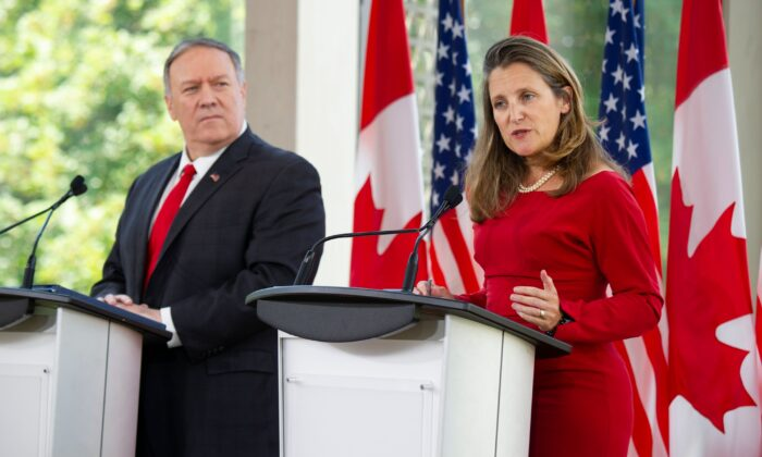 U.S. Secretary of State Mike Pompeo listens to Canadian Foreign Minister Chrystia Freeland speak during a joint press conference in Ottawa on Aug. 22, 2019. (Sebastien St-Jean/AFP/Getty Images)