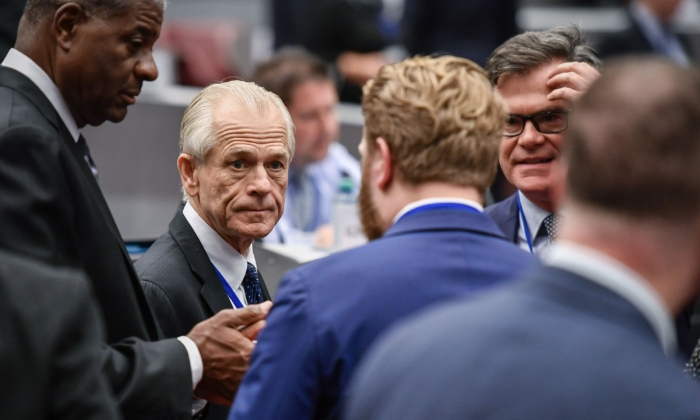 White House trade advisor Peter Navarro (L) looks on during a break during an extraordinary congress of the Universal Postal Union (UPU) with the US threatening to quit the global body as early as next month, in Geneva on Sept. 24, 2019. (Fabrice Coffrini/AFP/Getty Images)