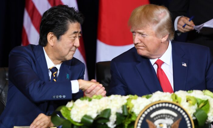 US President Donald Trump and Japanese Prime Minister Shinzo Abe shake hands during a meeting on trade in New York on the sidelines of the United Nations General Assembly, on Sept. 25, 2019. (SAUL LOEB/AFP/Getty Images)