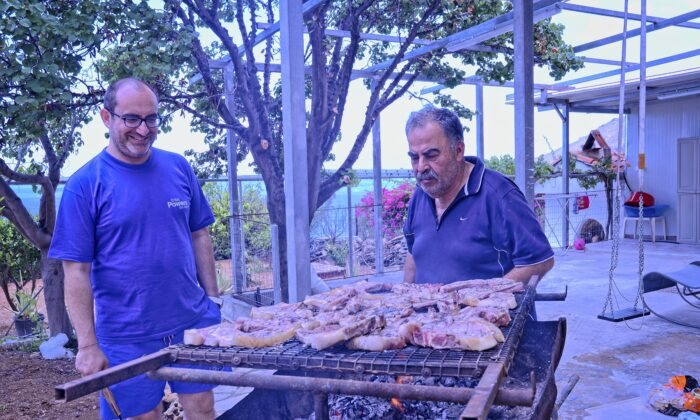Minas Liapakis and his father-in-law Nikos Merkoulidis cooking out in Tsoutsouras. (Phil Butler)