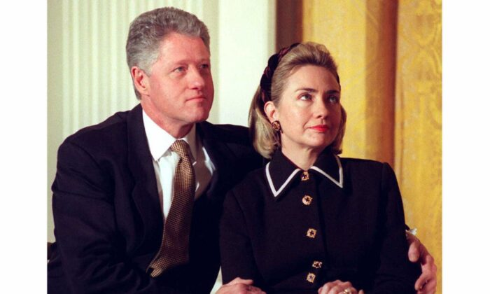 Then-President Bill Clinton (L) and First Lady Hillary Clinton listen to speakers at a Coalition for America's Children event at the White House in Washington on March 3, 1997. (JOYCE NALTCHAYAN/AFP/Getty Images)