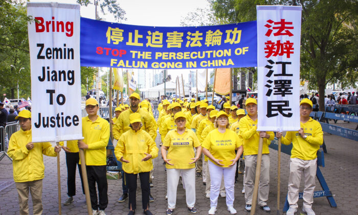 Falun Gong practitioners protest the persecution inside China at United Nations Plaza on Sept. 24, 2019. (Eva Fu/The Epoch Times)