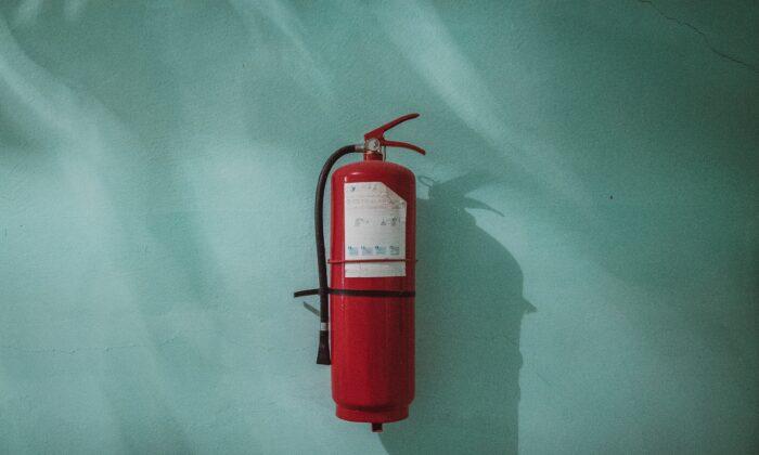 Stock photo of a fire extinguisher. (Piotr Chrobot/Unsplash)