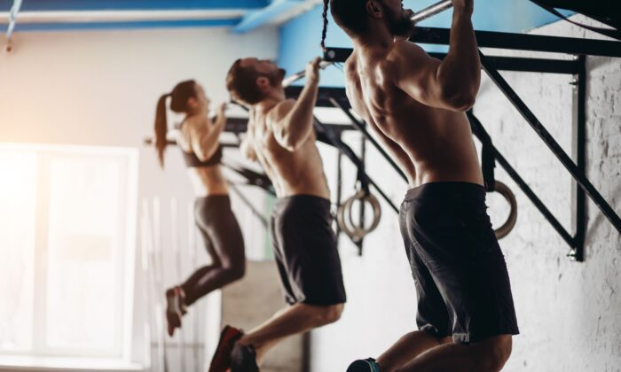 Pull-ups offer a whole-body workout without a gym, trainer, or expensive equipment. (UfaBizPhoto/Shutterstock)