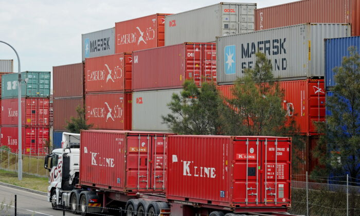 Shipping goods containers (below) are driven into the Port Botany Container Terminal near Sydney on Sept. 1, 2010. (Greg Wood/AFP/Getty Images)