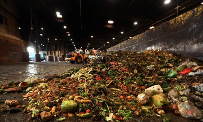 "At the Waste Management facility in North Brooklyn, tons of leftover food sits piled up before being processed into ""bio-slurry,"" in New York, in this Aug. 29, 2018 photo. A team of scientists spent weeks combing through the garbage of dozens of households to come up with what they say is the most accurate measure yet of how much food is wasted in Canadian kitchens. (The Canadian Press/AP/Stephen Groves)"