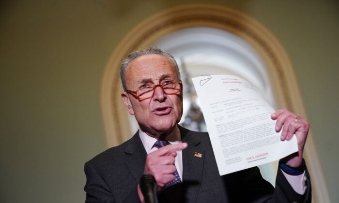 Senate Minority Leader Chuck Schumer (D-N.Y.) speaks to reporters as he holds a transcript of the phone call between President Donald Trump and Ukraine President Volodymyr Zelensky, during a press conference at the US Capitol in Washington on Sept. 25, 2019. (MANDEL NGAN/AFP/Getty Images)