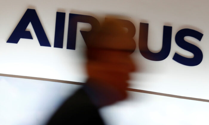 A man walks past an Airbus logo at the Langkawi International Maritime and Aerospace Exhibition in Langkawi, Malaysia on March 28, 2019. (Feline Lim/Reuters)