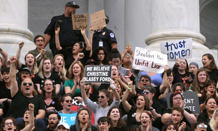 Hundreds of protesters occupy the center steps of the East Front of the U.S. Capitol after breaking through barricades to demonstrate against the confirmation of Supreme Court nominee Judge Brett Kavanaugh Oct. 06, 2018 in Washington.(Chip Somodevilla/Getty Images)