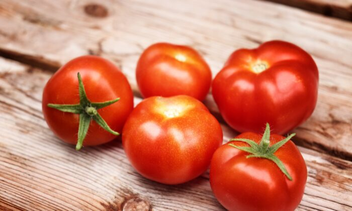 Tomatoes in a stock image. (Karen Stahlros/Unsplash)