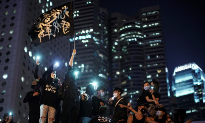 Anti-government protesters attend a rally at Edinburgh Place to show solidarity for arrested political activists being held at San Uk Ling detention center in Hong Kong, China on Sept. 27, 2019. (Athit Perawongmetha/Reuters)