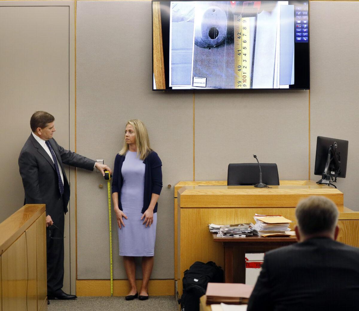 Officer cries recalling night she shot neighbor