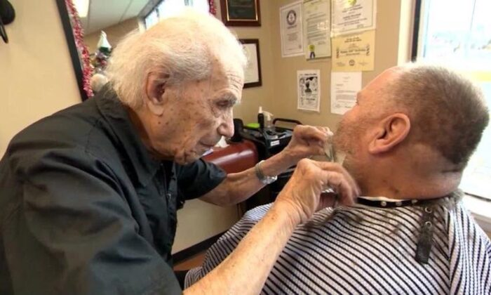Anthony Mancinelli trims a customer's beard in Fantastic Cuts in New Windsor, New York. (CNN)
