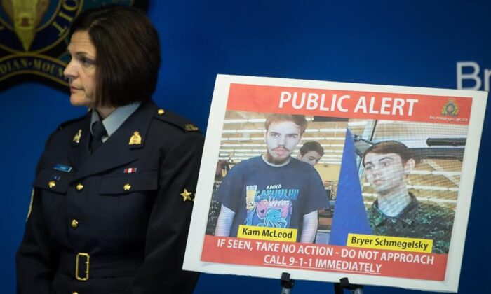 Security camera images recorded in Saskatchewan of Kam McLeod, 19, and Bryer Schmegelsky, 18, are displayed as RCMP Sgt. Janelle Shoihet listens during a news conference in Surrey, B.C., on July 23, 2019. (The Canadian Press/Darryl Dyck)