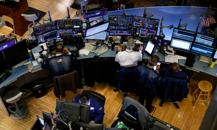 Traders work on the floor at the New York Stock Exchange (NYSE) in New York, U.S. on Sept. 9, 2019. (Brendan McDermid/Reuters)