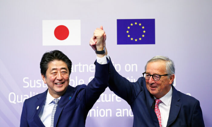 European Commission President Jean-Claude Juncker and Japan's Prime Minister Shinzo Abe gesture during the conference Communication Connecting Europe and Asia, in Brussels, Belgium on Sept. 27, 2019. (Francois Lenoir/Reuters)