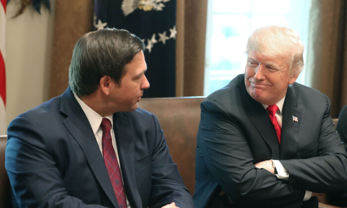 Florida Governor-elect Ron DeSantis (R) sits next to then- President Donald Trump during a meeting with Governors elects in the Cabinet Room at the White House in Washington on on Dec. 13, 2018. (Mark Wilson/Getty Images)