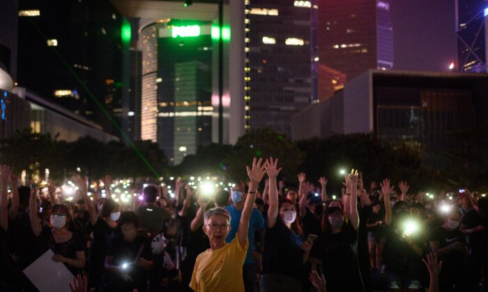 """People attend a rally to mark the fifth anniversary of the """"Umbrella Movement,"""" in the Admiralty area of Hong Kong on Sept. 28, 2019. (Philip Fong/AFP/Getty Images)"""