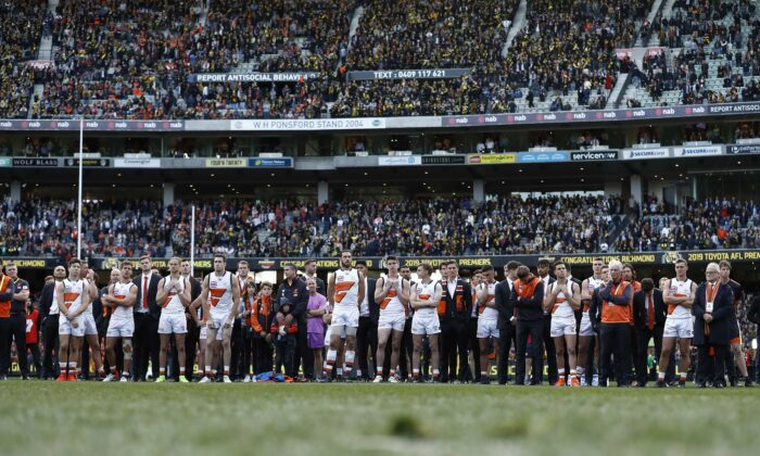 The Giants look dejected after during the 2019 AFL Grand Final match between the Richmond Tigers and the Greater Western Sydney Giants at Melbourne Cricket Ground in Melbourne, Australia, on Sept. 28, 2019. (Ryan Pierse/AFL Media/via Getty Images )