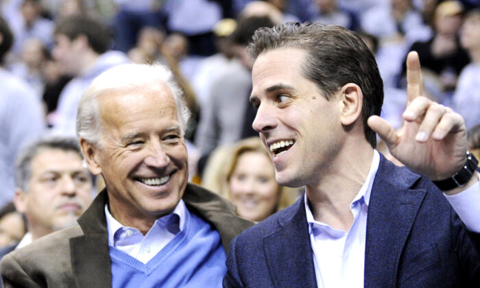 Former Vice President Joe Biden (L) and his son Hunter Biden at the Duke Georgetown NCAA college basketball game in Washington on Jan. 30, 2010. (Nick Wass/AP Photo)