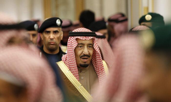 Saudi Arabia's King Salman is guarded by his bodyguard Maj. Gen. Abdulaziz al-Fagham (background), as he attends a ceremony at the Diwan royal palace in Riyadh, Saudi Arabia, on Jan. 24, 2015. (Yoan Valat/AP Photo)