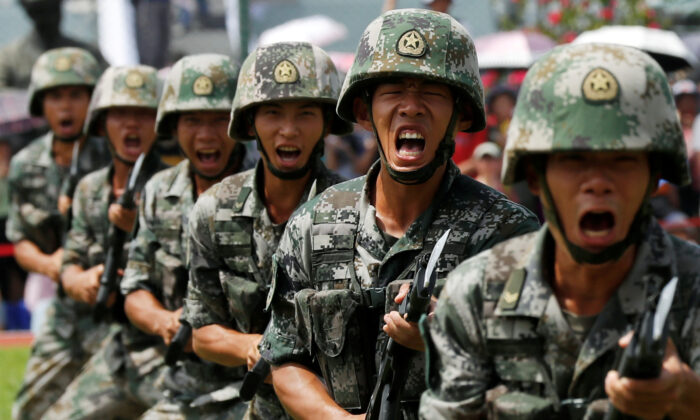 People's Liberation Army (PLA) soldiers take part in a performance during an open day at Stonecutters Island naval base in Hong Kong, on June 30, 2019. (Tyrone Siu/Reuters)