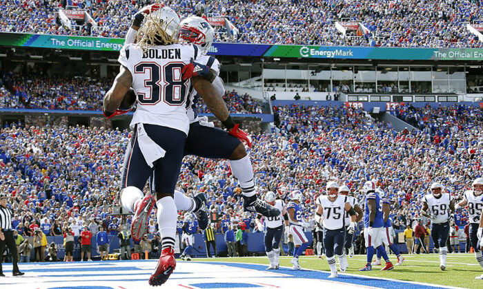 New England Patriots Running Back Brandon Bolden (L) celebrates his touchdown run against the Buffalo Bills at New Era Field in Orchard Park, N.Y., on Sept. 29, 2019. (AP Photo/Ron Schwane)