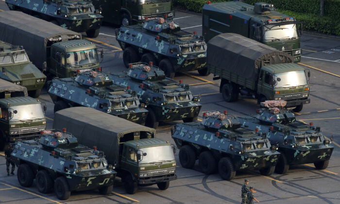 Military vehicles are parked on the grounds of the Shenzhen Bay Sports Center in Shenzhen, China on Aug. 15, 2019. (Thomas Peter/Reuters)