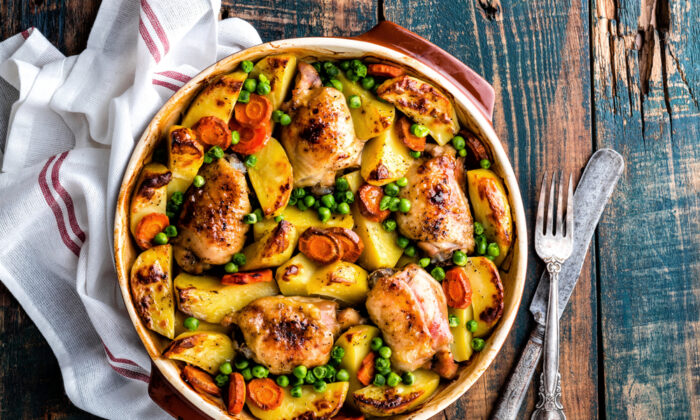 Chicken and vegetables, rice and beans, a pan of sliced fruit—all transform in the heat of the oven, with little hands-on effort required. (Shutterstock)