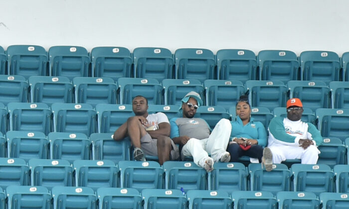 Miami Dolphins fans sit in the upper deck during the fourth quarter of the game against the Los Angeles Chargers at Hard Rock Stadium on September 29, 2019 in Miami, Florida. (Photo by Eric Espada/Getty Images)