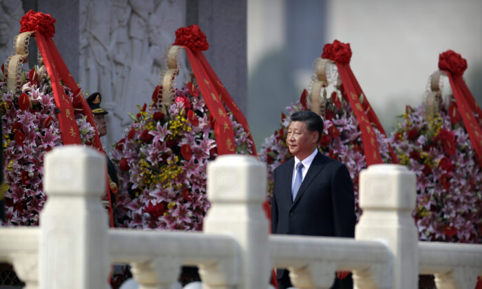 Chinese leader Xi Jinping walks past floral wreaths at the Monument to the People's Heroes during a ceremony at Tiananmen Square in Beijing on Sept. 30, 2019. (Mark Schiefelbein - Pool/Getty Images)