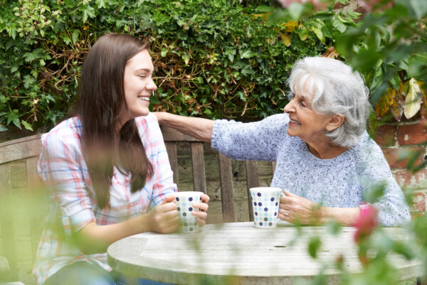 Granddaughter and Grandmother In Garden