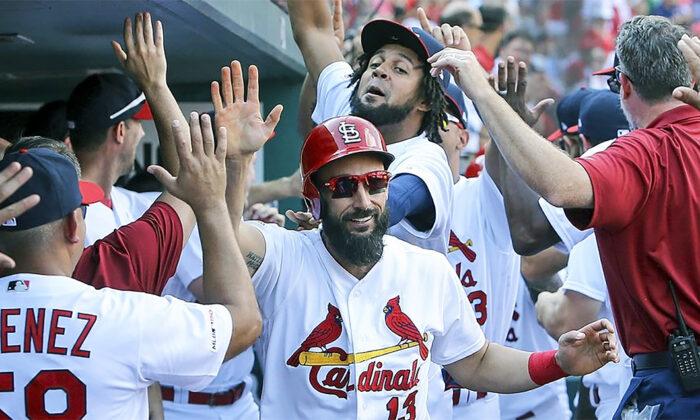 St. Louis Cardinals Infielder Matt Carpenter (C) gives high fives after hitting a three-run home run at Busch Stadium in St. Louis, Mo., on Sept. 29, 2019. (Scott Kane/AP Photo)