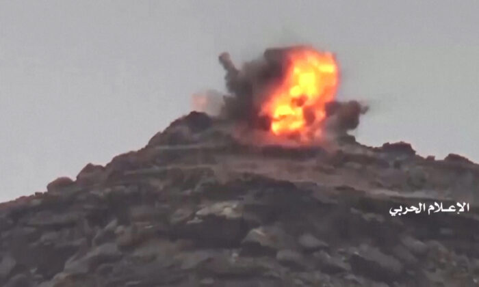 An explosion is seen during an alleged attack of Houthi forces at Saudi positions near the border with Saudi Arabia's southern region of Najran in Yemen, in this still image taken from video on Sept. 29, 2019. (Al Masirah/Houthi Military Media Center/Reuters TV via REUTERS)