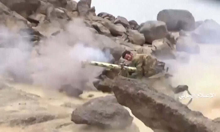 A member of Houthi forces fires on alleged Saudi positions during an attack near the border with Saudi Arabia's southern region of Najran in Yemen, in this still image taken from video on Sept. 29, 2019. (Al Masirah/Houthi Military Media Center/Reuters TV via REUTERS)
