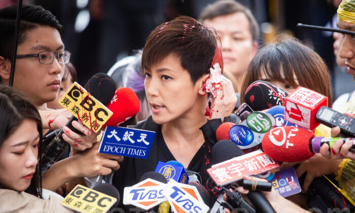 Hong Kong singer and activist Denise Ho continues to speak to the media after an attacker poured red in over her hair in Taipei, Taiwan, on Sept. 29, 2019. (Chen Po-chou/The Epoch Times)