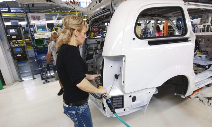 A worker on the production line at Chrysler's assembly plant in Windsor, Ont., in a file photo.  (The Canadian Press/Geoff Robins)