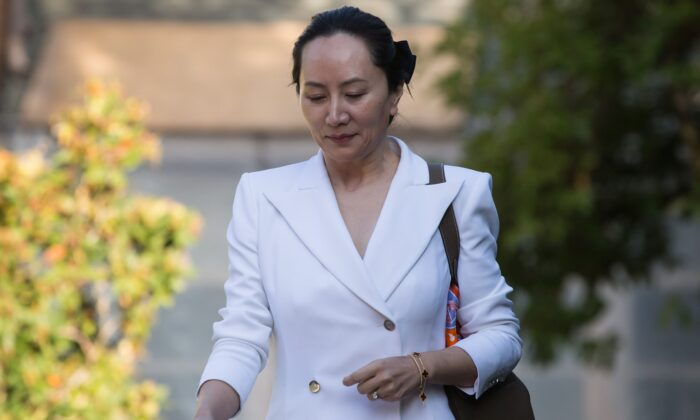 Huawei CFO Meng Wanzhou, who is out on bail and remains under partial house arrest after she was detained last year at the behest of American authorities, leaves her home to attend a court hearing in Vancouver on Sept. 30, 2019. (THE CANADIAN PRESS/Darryl Dyck)