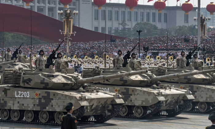 Chinese soldiers sit atop tanks as they drive in a parade to celebrate the 70th anniversary of the Communist Party's takeover of China, at Tiananmen Square in Beijing on Oct. 1, 2019. (Kevin Frayer/Getty Images)