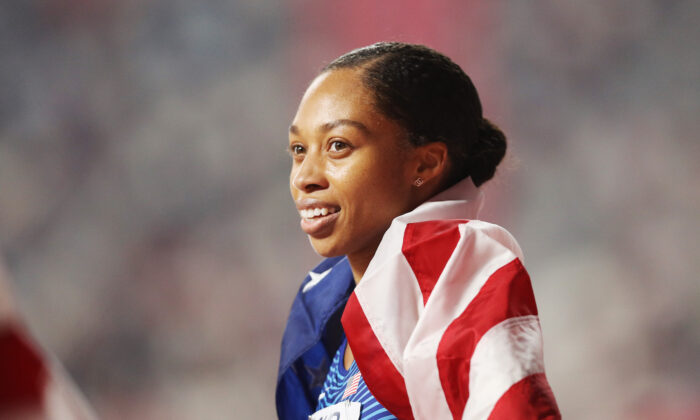 Allyson Felix of the United States reacts after setting a new world record in the 4x400 meter mixed relay during day three of 17th IAAF World Athletics Championships Doha 2019 at Khalifa International Stadium in Doha, Qatar, on Sept. 29, 2019. (Patrick Smith/Getty Images)